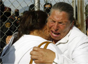 Family members mourn the loss of inmates killed in prison riot where 44 were left dead.