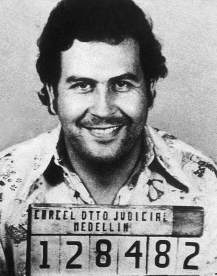 Image of a smiling Pablo Escobar being booked into jail