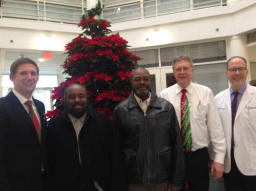 Wiley Bridgeman and Kwami Ajamu with the staff at Cleveland Eye Clinic